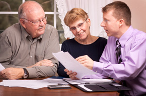 Photo of Canadian Insurance Broker with elderly couple