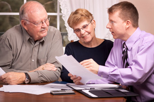 Photo of Senior Couple talking to Insurance Agent